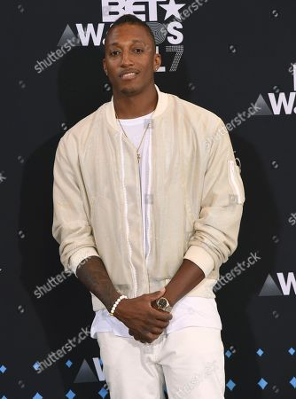 Lecrae, winner of the Dr. Bobby Jones best gospel/inspirational award, poses in the press room at the BET Awards at the Microsoft Theater, in Los Angeles