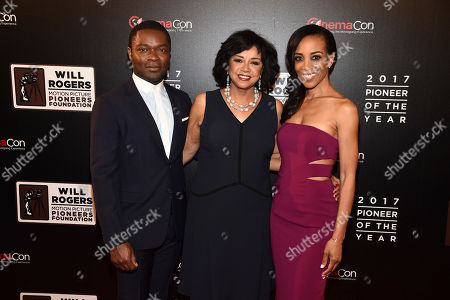 """David Oeylowo, Cheryl Boone Isaacs, and Shaun Robinson attend the 2017 Will Rogers """"Pioneer of the Year"""" Dinner Honoring Cheryl Boone Isaacs during CinemaCon at The Colosseum at Caesars Palace, in Las Vegas"""