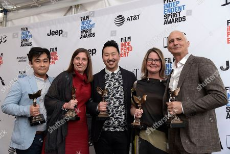 "Ki Jin Kim, from left, Giulia Caruso, Andrew Ahn, Kelly Thomas, and David Ariniello pose with the John Cassavetes award for ""Spa Night"" in the press room at the Film Independent Spirit Awards, in Santa Monica, Calif"