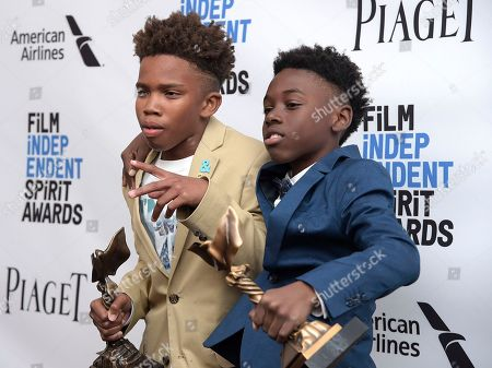 """Jaden Piner, left, and Alex R. Hibbert pose with their awards for best feature for """"Moonlight"""" in the press room at the Film Independent Spirit Awards, in Santa Monica, Calif"""