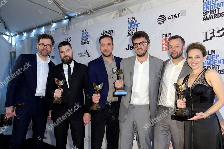"Stock Picture of Jay Van Hoy, from left, Robert Eggers, Daniel Bekerman, Rodrigo Teixeira, Lars Knudsen, and Jodi Redmond pose in the press room with their awards for best first feature for ""The Witch"" at the Film Independent Spirit Awards, in Santa Monica, Calif"