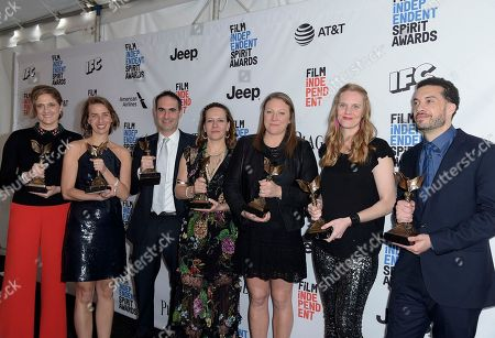 "Caroline Waterlow, from left, Tamara Rosenberg, Connor Schell, Nina Krstic, Deirdre Fenton, Libby Geist, and Ezra Edelman pose in the press room with their awards for best documentary for ""O.J.: Made in America"" at the Film Independent Spirit Awards, in Santa Monica, Calif"