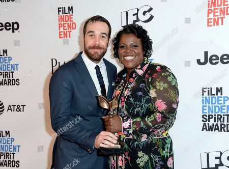 "Nat Sanders, left, and Joi McMillon pose in the press room with the award for best editing for ""Moonlight"" at the Film Independent Spirit Awards, in Santa Monica, Calif"