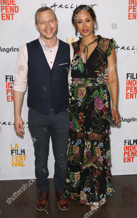 """Stock Photo of Micah Hauptman, left, and Margot Bingham arrive at the 2017 Los Angeles Film Festival world premiere of """"Anything"""", in Santa Monica, Calif"""
