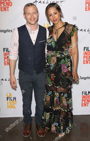 """Micah Hauptman, left, and Margot Bingham arrive at the Los Angeles Film Festival world premiere of """"Anything"""", in Santa Monica, Calif"""