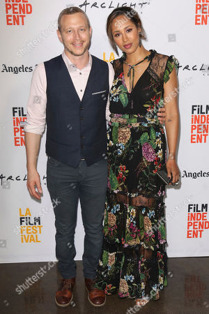 """Micah Hauptman, left, and Margot Bingham arrive at the 2017 Los Angeles Film Festival world premiere of """"Anything"""", in Santa Monica, Calif"""