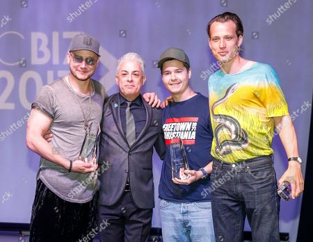 Mark Falgren, left, Lukas Forchhammer, second from the right, and Magnus Larsson, right, from the band Lukas Graham accept the Breakthrough Artist Award from Jim Donio at 2017 Music Biz - Music Business Artist Awards Luncheon at Renaissance Nashville Hotel, in Nashville, Tenn