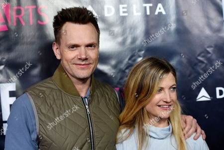 """Actor Joel McHale and his wife Sarah Williams pose together at the 2017 P.S. ARTS """"The pARTy!"""" at NeueHouse, in Los Angeles"""