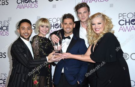 "Stock Picture of Tahj Mowry, from left, Chelsea Kane, Jean-Luc Bilodeau, Derek Theler, and Melissa Peterman pose in the press room with the award for favorite cable TV comedy for ""Baby Daddy"" at the People's Choice Awards at the Microsoft Theater, in Los Angeles"
