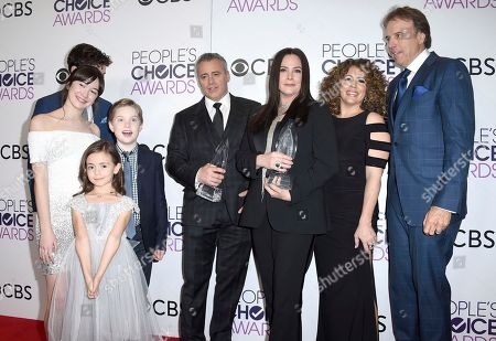 """Matt Cook, from left, Grace Kaufman, Hala Finley, Matthew McCann, Matt LeBlanc, Liza Snyder, Dina Maria Riva, and Kevin Nealon pose in the press room with the award for favorite new TV comedy series for """"Man with a Plan"""" at the People's Choice Awards at the Microsoft Theater, in Los Angeles"""