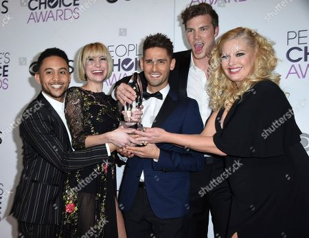 "Stock Photo of Tahj Mowry, from left, Chelsea Kane, Jean-Luc Bilodeau, Derek Theler, and Melissa Peterman pose in the press room with the award for favorite cable TV comedy for ""Baby Daddy"" at the People's Choice Awards at the Microsoft Theater, in Los Angeles"