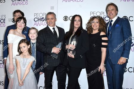 """Matt Cook, from left, Grace Kaufman, Hala Finley, Matthew McCann, Matt LeBlanc, Liza Snyder, Diana Maria Riva, and Kevin Nealon pose in the press room with the award for favorite new TV comedy for """"Man with a Plan"""" at the People's Choice Awards at the Microsoft Theater, in Los Angeles"""