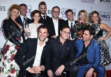 "Jodie Sweetin, front row from left, Jeff Franklin, Candace Cameron-Bure, John Brotherton, Dave Coulier, Scott Weinger, Lori Laughlin, Andrea Barber, and bottom row from left, Juan Pablo di Pace, Bob Saget, and John Stamos pose in the press room with the award for favorite premium comedy series for ""Fuller House"" at the People's Choice Awards at the Microsoft Theater, in Los Angeles"