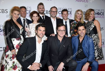 "Jodie Sweetin, back row from left, Jeff Franklin, Candace Cameron-Bure, John Brotherton, Dave Coulier, Scott Weinger, Lori Loughlin, Andrea Barber, and front row from left, Juan Pablo Di Pace, Bob Saget, and John Stamos pose in the press room with the award for favorite premium comedy series for ""Fuller House"" at the People's Choice Awards at the Microsoft Theater, in Los Angeles"