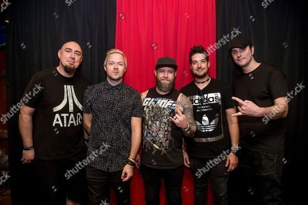 Aaron Bruch, from left, Keith Wallen, Jasen Rauch, Shaun Foist and Benjamin Burnley of Breaking Benjamin pose on board the Carnival Victory during day 2 of the ShipRocked cruise on in Miami