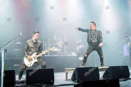 Jerry Horton, left, and Jacoby Shaddix of Papa Roach perform on board the Carnival Victory during day 3 of the ShipRocked cruise on in Miami