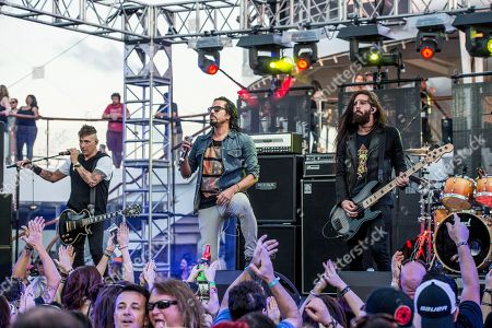 Dave Grahs, from left, Leigh Kakaty, and Matt DiRito of Pop Evil performs on board the Carnival Victory during day 3 of the ShipRocked cruise on in Miami