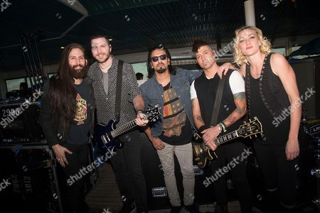 Stock Image of Matt DiRito, from left, Nick Fuelling, Leigh Kakaty, Dave Grahs, and Hayley Cramer of Pop Evil pose on board the Carnival Victory during day 3 of the ShipRocked cruise on in Miami