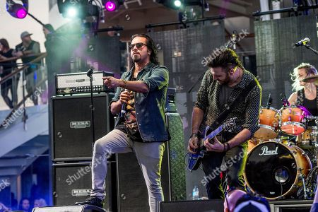 Leigh Kakaty, left, and Nick Fuelling of Pop Evil perform on board the Carnival Victory during day 3 of the ShipRocked cruise on in Miami