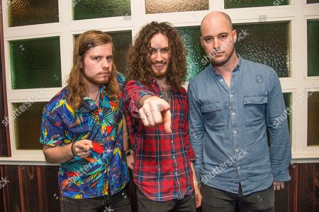 Kev Hickman, from left, Oli Brown, and Aaron Spiers of Raven Eye pose on board the Carnival Victory during day 4 of the ShipRocked cruise on in Miami