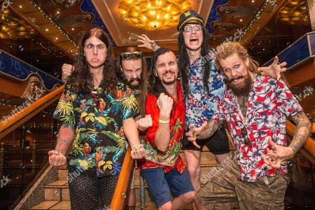 Henrik Sandelin, fom left, Jonas Jarlsby, John Alfredsson, Johannes Eckerstrom, and Tim Ohrstrom pose on board the Carnival Victory during day 4 of the ShipRocked cruise on in Miami