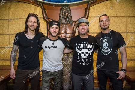 Myles Kennedy, from left, Brian Marshall, Scott Phillips and Mark Tremonti of Alter Bridge pose on board the Carnival Victory during day 4 of the ShipRocked cruise on in Miami