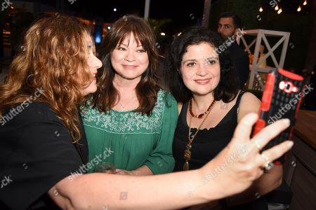 Valerie Bertinelli, center, and Alex Guarnaschelli, right attend the 'Barilla's Italian Bites' event at the South Beach Wine & Food Festival on in Miami Beach, Fla