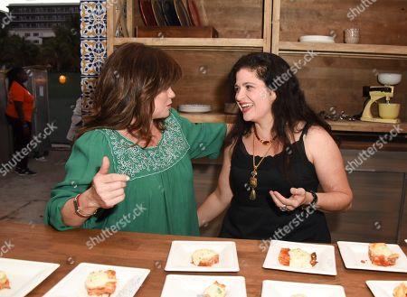 Valerie Bertinelli, left, and Alex Guarnaschelli attend the 'Barilla's Italian Bites' event at the South Beach Wine & Food Festival on in Miami Beach, Fla