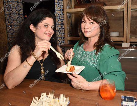 Alex Guarnaschelli, left, and Valerie Bertinelli attend the 'Barilla's Italian Bites' event at the South Beach Wine & Food Festival on in Miami Beach, Fla