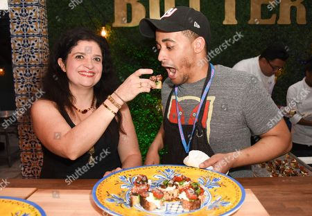 Alex Guarnaschelli, left, and Michael Jenkins attend the 'Barilla's Italian Bites' event at the South Beach Wine & Food Festival on in Miami Beach, Fla