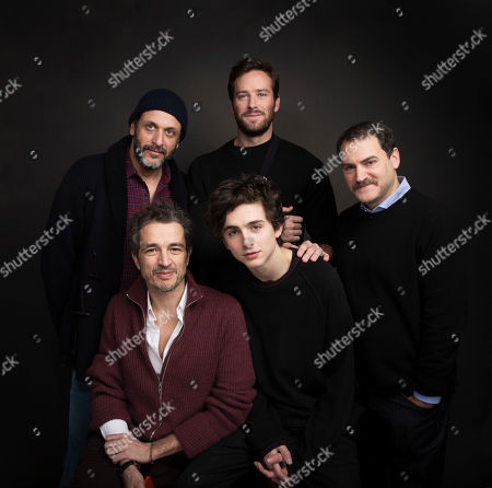 """Director Luca Guadagnino, clockwise from left, actor Armie Hammer, actor Michael Stuhlbarg, actor Timothee Chalamet and editor Walter Fasano pose for a portrait to promote the film, """"Call Me By Your Name"""", at the Music Lodge during the Sundance Film Festival, in Park City, Utah"""