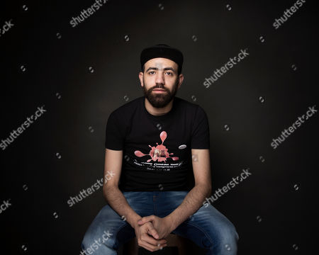 """Abdalaziz Alhamza poses for a portrait to promote the film, """"City of Ghosts"""", at the Music Lodge during the Sundance Film Festival, in Park City, Utah"""