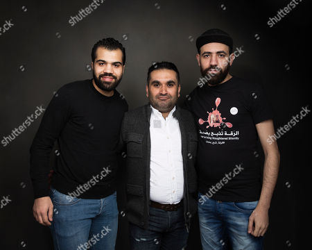 """Hamoud Almousa, from left, Mohamad Almusari and Abdalaziz Alhamza pose for a portrait to promote the film, """"City of Ghosts"""", at the Music Lodge during the Sundance Film Festival, in Park City, Utah"""