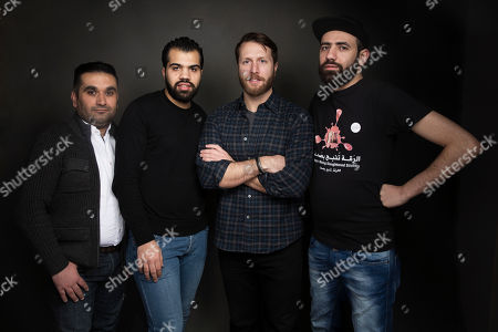 """Mohamad Almusari, from left, Hamoud Almousa, director Matthew Heineman and Abdalaziz Alhamza pose for a portrait to promote the film, """"City of Ghosts"""", at the Music Lodge during the Sundance Film Festival, in Park City, Utah"""