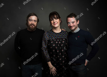 """Actor Melanie Lynskey, from left, director Macon Blair and actor Elijah Wood pose for a portrait to promote the film, """"I Don't Feel at Home in This World Anymore,"""" at the Music Lodge during the Sundance Film Festival, in Park City, Utah"""