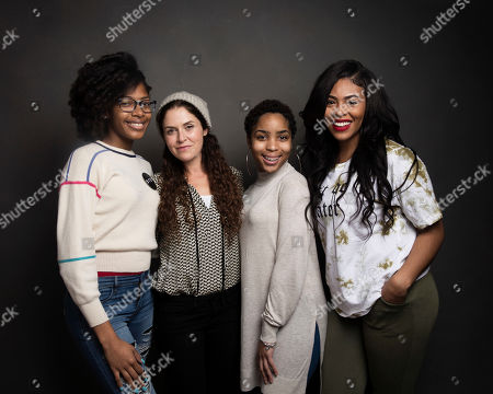 """Director Amanda Lipitz, second from left, poses for a portrait with dancers Cori Grainger, left, Talya Solomon and Blessin Giraldo, right, to promote the film, """"Step"""", at the Music Lodge during the Sundance Film Festival, in Park City, Utah"""