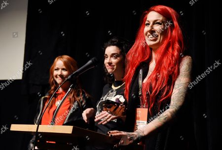 "Jovanka Vuckovic, right, one of the directors of ""XX,"" introduces the film along with fellow directors Roxanne Benjamin, left, and Annie Clark at the premiere of the film at the Library Center Theatre during the 2017 Sundance Film Festival, in Park City, Utah. The film is a horror anthology featuing four female directors"