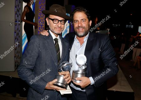 """Fisher Stevens, left, and Brett Ratner, winners of the Television Academy Award for """"Before The Flood"""" are seen at the 2017 Television Academy Honors at the Montage Hotel, in Beverly Hills, Calif"""