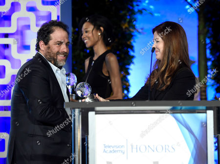 """Brett Ratner accepts the Television Academy Award for """"Before The Flood"""" at the 2017 Television Academy Honors at the Montage Hotel, in Beverly Hills, Calif. Dana Delany, right"""