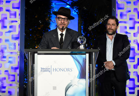 """Fisher Stevens, left, and Brett Ratner accept the Television Academy Award for """"Before The Flood"""" at the 2017 Television Academy Honors at the Montage Hotel, in Beverly Hills, Calif"""
