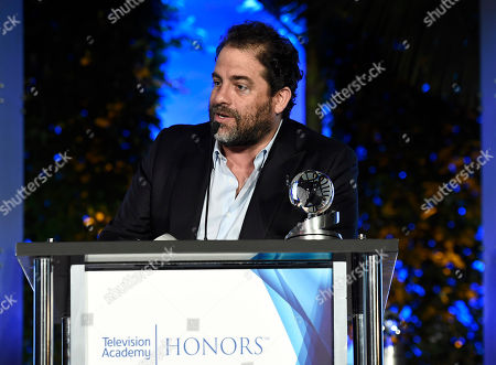 """Brett Ratner accepts the Television Academy Award for """"Before The Flood"""" at the 2017 Television Academy Honors at the Montage Hotel, in Beverly Hills, Calif"""