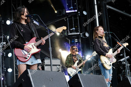 Theresa Wayman, from left, Jenny Lee Lindberg and Emily Kokal from the band Warpaint perform on day three of the Governors Ball Music Festival, in New York