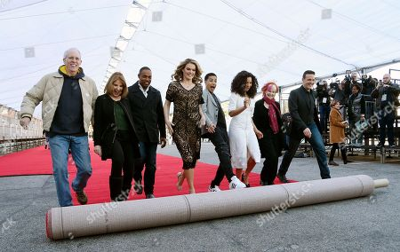 Screen Actors Guild Awards executive producer Kathy Connell, second from left, and Screen Actors Guild members, left to right, Daryl Anderson, Kathy Connell, Jason George, Missi Pyle, Marcus Scribner, Jurnee Smollett-Bell, Shelley Fabares and Woody Schultz roll out the red carpet for Sunday's SAG Awards ceremony at the Shrine Auditorium, in Los Angeles