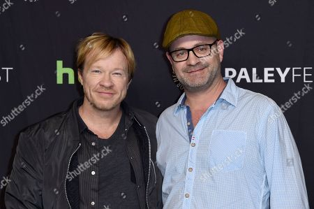"""John Fawcett, co-creator/director, left, and Graeme Manson, co-creator/executive producer, attend the 34th annual PaleyFest: """"Orphan Black"""" event at the Dolby Theatre, in Los Angeles"""