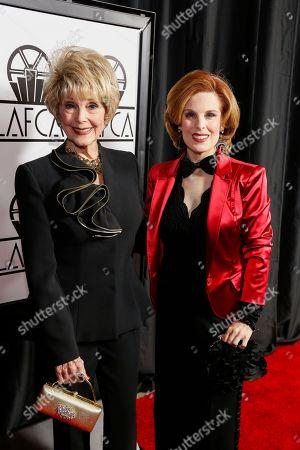 Karen Sharpe, left, and Kat Kramer arrive at the 42nd Annual Los Angeles Film Critics Association Awards, in Los Angeles