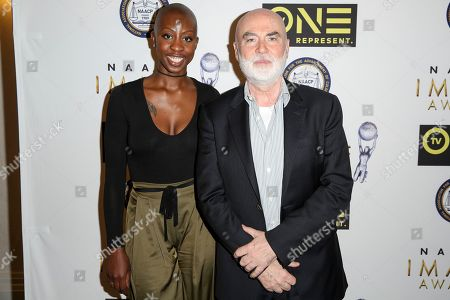 Oge Egbuonu, left, and Ged Doherty arrive at the 48th NAACP Image Awards Nominees' Luncheon at the Loews Hollywood Hotel, in Los Angeles