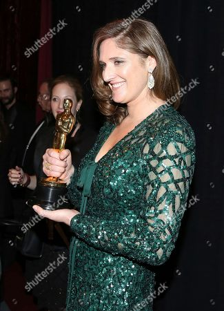 """Caroline Waterlow, winner of the award for best documentary feature for """"O.J.: Made in America"""", appears backstage at the Oscars, at the Dolby Theatre in Los Angeles"""