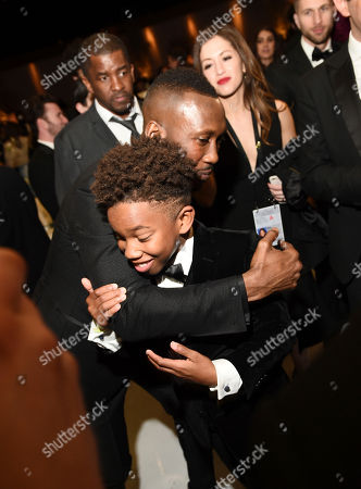 Stock Photo of Mahershala Ali, left, hugs Jaden Piner at the Governors Ball after the Oscars, at the Dolby Theatre in Los Angeles