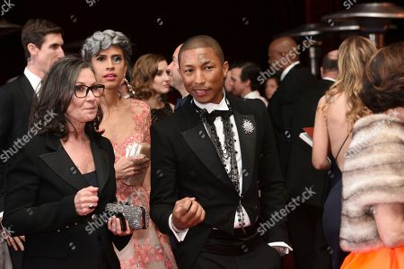Mimi Valdes, left, and Pharrell Williams attend the Governors Ball after the Oscars, at the Dolby Theatre in Los Angeles