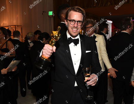 """Andrew R. Jones poses with his award for best visual effects for """"The Jungle Book"""" at the Governors Ball after the Oscars, at the Dolby Theatre in Los Angeles"""